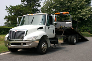 white flatbed tow truck