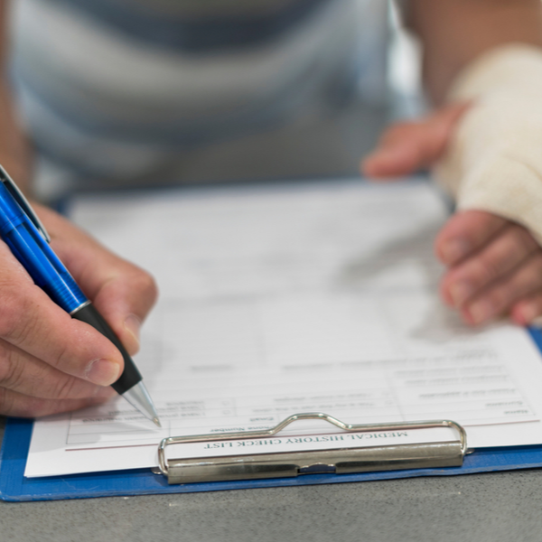 person filling personal injury claim after injury